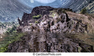 Snowing over rocky mountain reflected in water