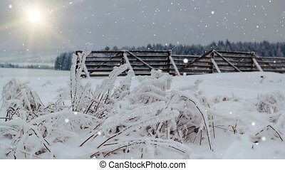 snowing winter landscape with sun and snow barrier,...