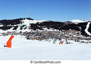 ski track in french alpine mountain - snowmaker on ski track...