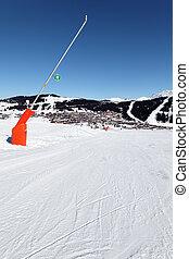 ski track in french alps - snowmaker on ski track in french...