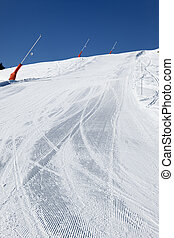 snowmaker on ski track in french mountain