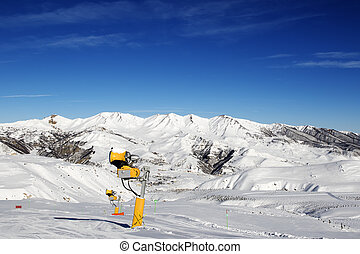 Snowmaking in ski slope at sun day. Greater Caucasus, Mount...