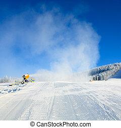 Snowmaking on a mountain ski resort and winter calm mountain...