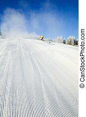Snowmaking on a mountain ski resort - winter mountain...