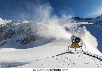 snowmaking - snow cannon working on the slope