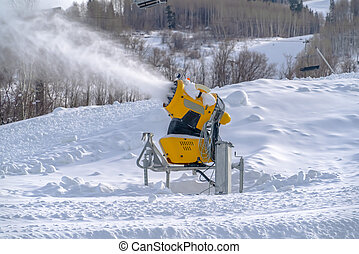 Snowmaking with snow cannons in Park City Utah. Snowmaking...