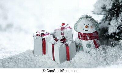 Snowman and christmas gifts under snow - Small decorative...