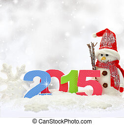 Snowman and new year 2015 on snow