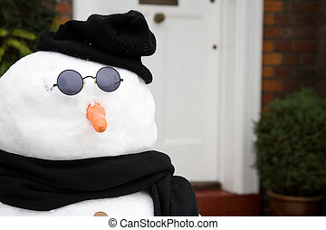 Snowman at front door - Snowman outside the front door of a...