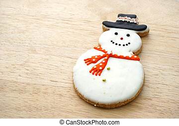 Snowman Cookie on Wood Background