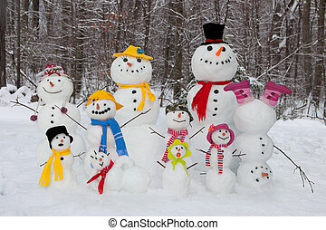 Snowman family. Happy and cute snowmen outdoors.