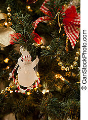 Snowman hanging on a Christmas tree