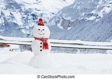 Snowman in Alps mountains. Snow man in winter. - Snowman in...