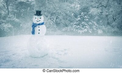 Snowman with hat and scarf with snow falling