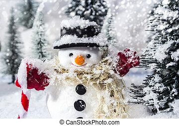 Snowman in pine woods during winter for christmas