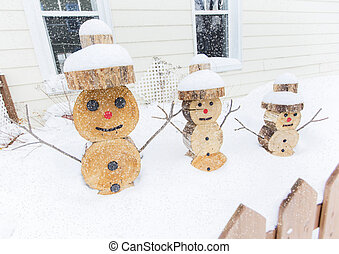 snowman made in piece of wood with fence on the front
