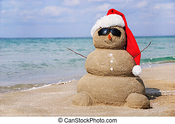 Snowman made out of sand. Holiday concept can be used for New Year and Christmas Cards