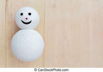 Snowman on wooden