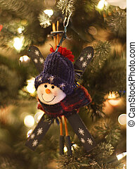 Snowman skier Christmas ornament on tree with focus on face