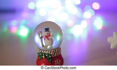 Snowman toy on shiny silver background. Christmas and New...