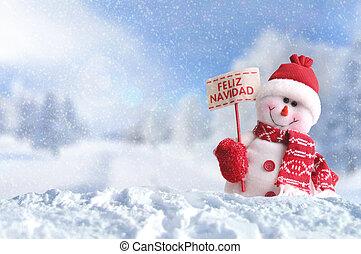 Snowman with a placard Feliz Navidad on the snow