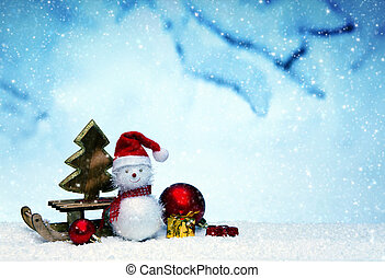 Snowman with Christmas gifts on the sledge isolated .