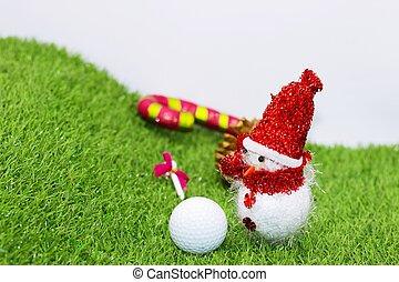 Snowman with golf ball on green grass