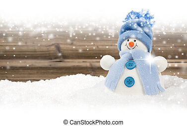Snowman with snowfall - Photo of blue snowman on wooden...