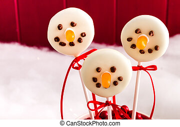 Snowmen and Reindeer Cake Pops - Close up of snowmen cake...