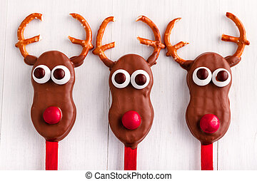 Snowmen and Reindeer Cake Pops - Line of holiday reindeer...
