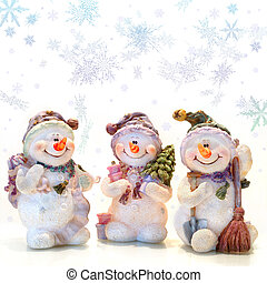 Snowmen and Snowflakes - Three smiling snowmen with a...
