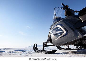 Snowmobile - A snowmobile detail on a barren winter...