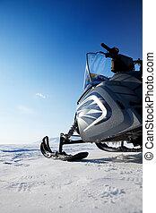 Snowmobile - A snowmobile detail on a barren winter ...