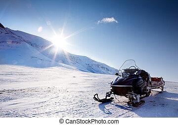 Snowmobile - A snowmobile in a winter mountain landscape