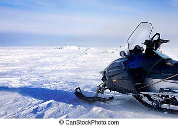 Snowmobile - A snowmobile on a barren winter landscape