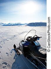 Snowmobile - A snowmobile on a winter landscape