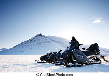 Snowmobile - A snowmobile on frozen ice on a barren winter...