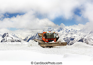 Snowmobile dune buggy vehicle in mountains