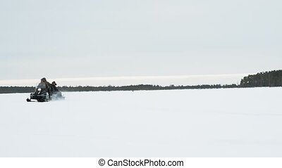 snowmobile on the ice lake