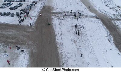 Snowmobile races in the winter season. Championship on snowmobiles January 27, 2018