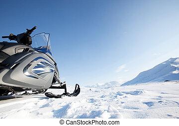 Snowmobile Winter Landscape - A snowmobile on a winter...