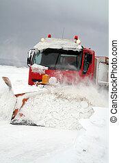 snowplow in winter snow storm