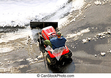 Snowplow - Man cleaning the road covered in snow
