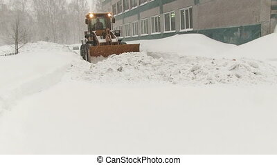 Snowplow removes a lot of snow in the city - NOVOSIBIRSK,...
