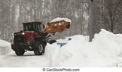 Snowplow removes a lot of snow in the city - NOVOSIBIRSK, ...