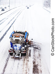 Snowplow removing the Snow from the Highway during a ...