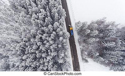 Snowplow truck maintaining road