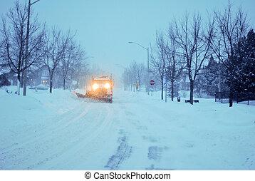Snowplowing truck on a suburban street