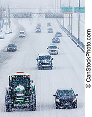 Snowplows and Cars on the Highway