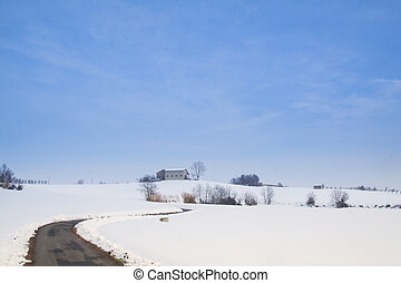 Snowscape - Snowy landscape with a road climbing over a hill